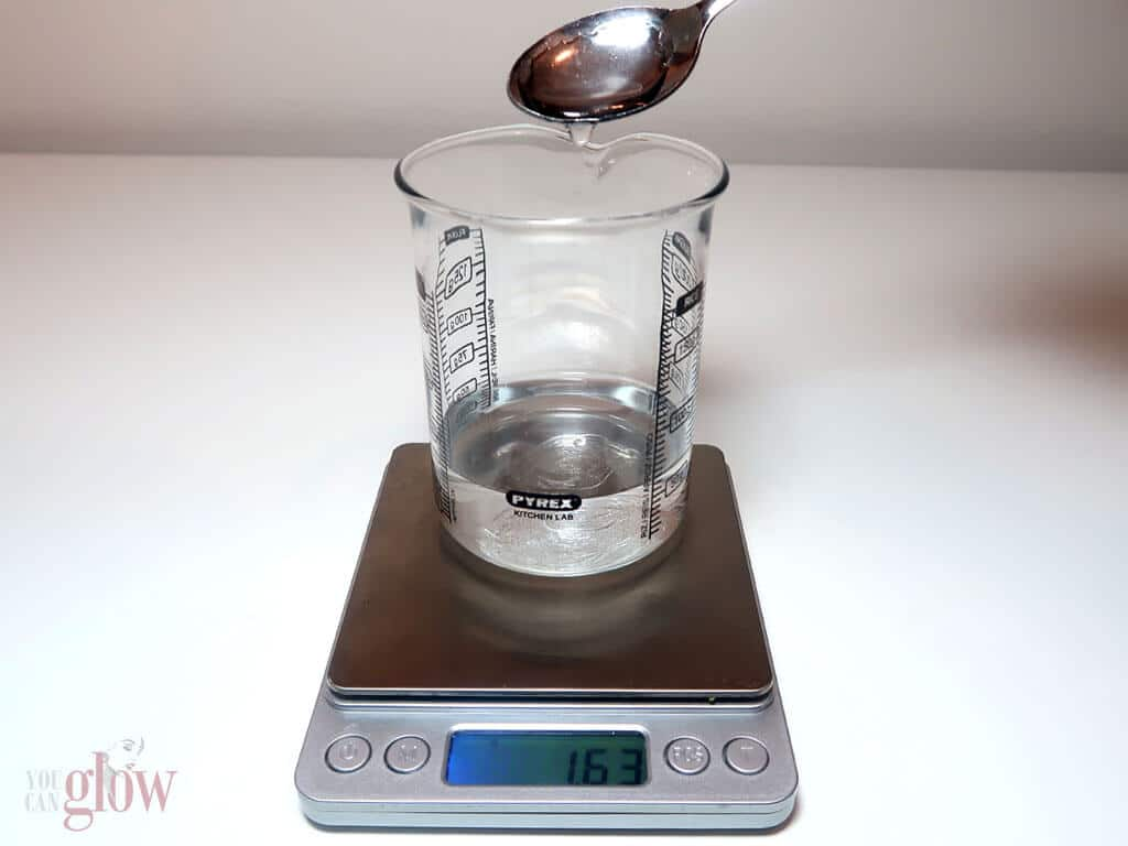 In a small Pyrex jug or beaker, weigh out and mix together your water and glycerine.